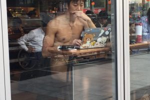fundoshigentleman-working-with-pc-in-starbucks
